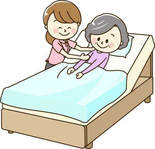 高齢者を介護する介護士